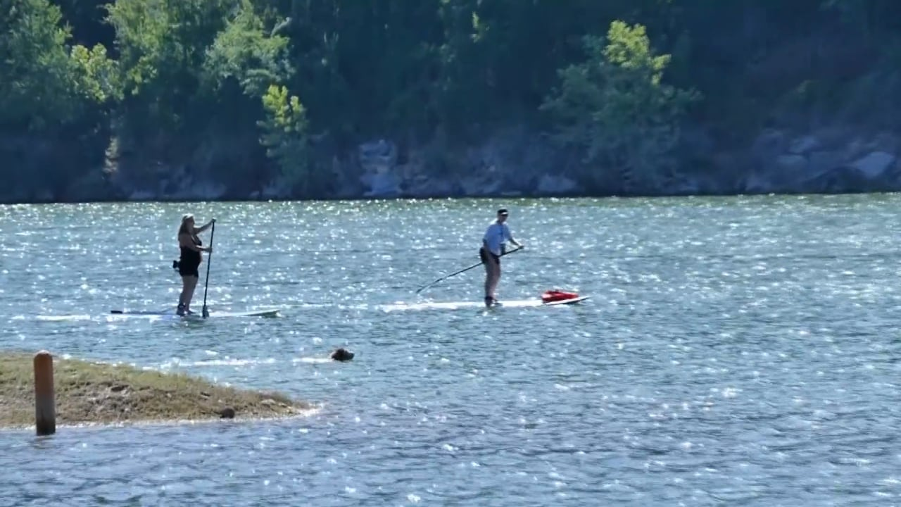 People paddle boarding near lake in Jonestown, TX