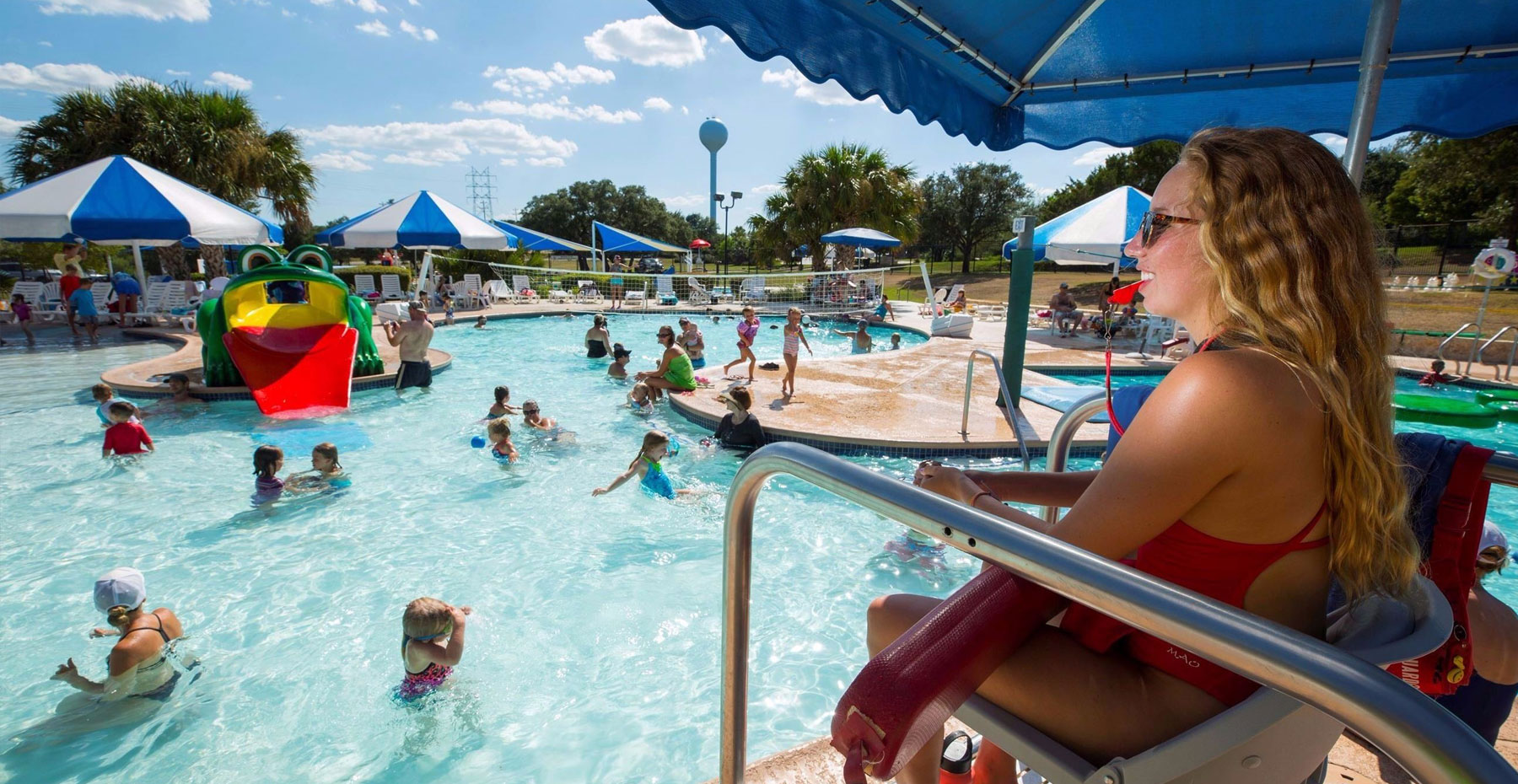 Community waterpark in Lakeway TX with residents enjoying the water and amenities.