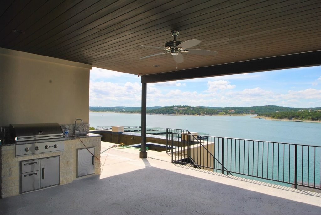 covered patio with built-in outdoor kitchen area